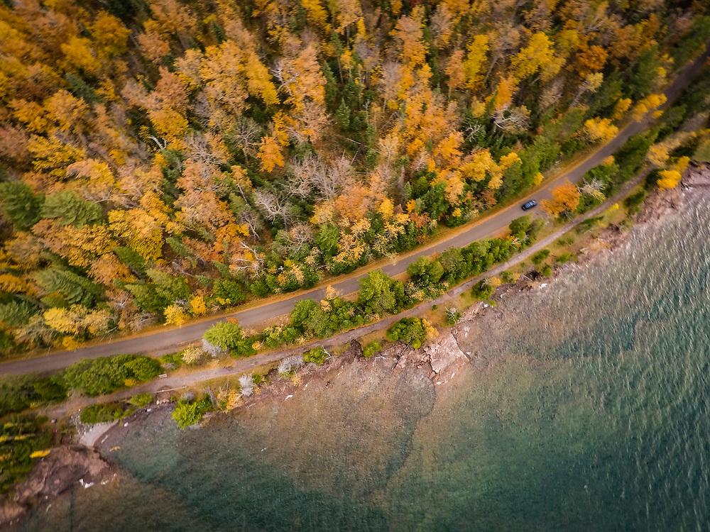 Fall color drone photos of the Lake Superior shoreline at Presque Isle Park in Marquette Michigan.