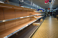Empty shelves at lidle Totton people stockpile food and cleaning supplies as fears grow of a 14 day quarantine uk photo by Michael Palmer
