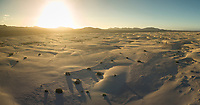 Aerial panoramic view of sunset in the dunes of Corralejo  Natural Park in Fuerteventura, Canary Islands.