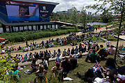 In the Olympic Park, Brits watch Team GB swimmer Rebecca Adlington in another winning heat in the Olympic Park during the London 2012 Olympics. This land was transformed to become a 2.5 Sq Km sporting complex, once industrial businesses and now the venue of eight venues including the main arena, Aquatics Centre and Velodrome plus the athletes' Olympic Village. After the Olympics, the park is to be known as Queen Elizabeth Olympic Park.