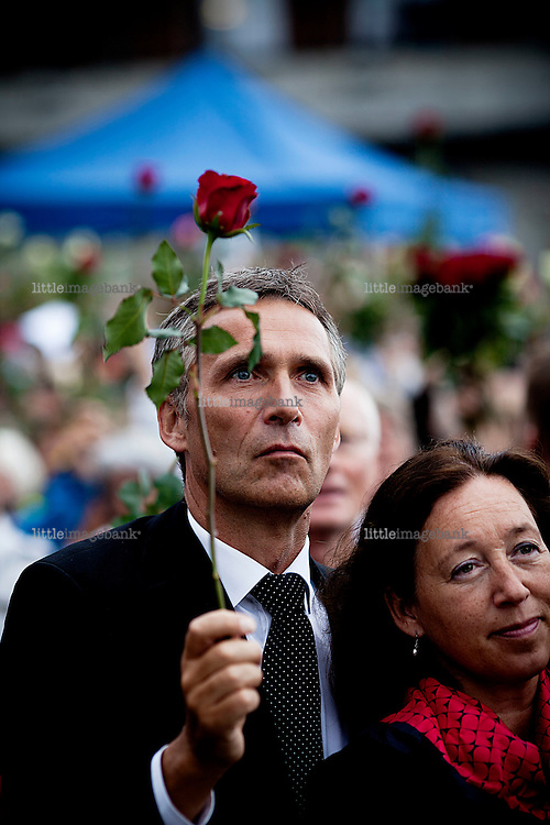 Oslo, Norway, 25.07.2011. Prime minister Jens Stoltenberg. An initiative on facebook by a citizen of Oslo resulted after only a few hours that aproximately 200.000 citizens of Oslo met in Rådhusplassen, a square by the harbour to honour the inocent civilans massacred on friday 23. of july. The Prime minister Jens Stoltenberg, along with his coalition government as well the royal family and high profile norwegian artist performing on stage. As the summer in Norway never gets really dark, people brought roses instead of torches. Foto: Christopher Olssøn.