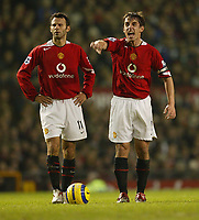 Photo: Aidan Ellis.<br /> Manchester United v Everton. The Barclays Premiership.<br /> 11/12/2005.<br /> United captain Gary Neville shouts at team mates as Ryan Giggs lines up a dfree kick