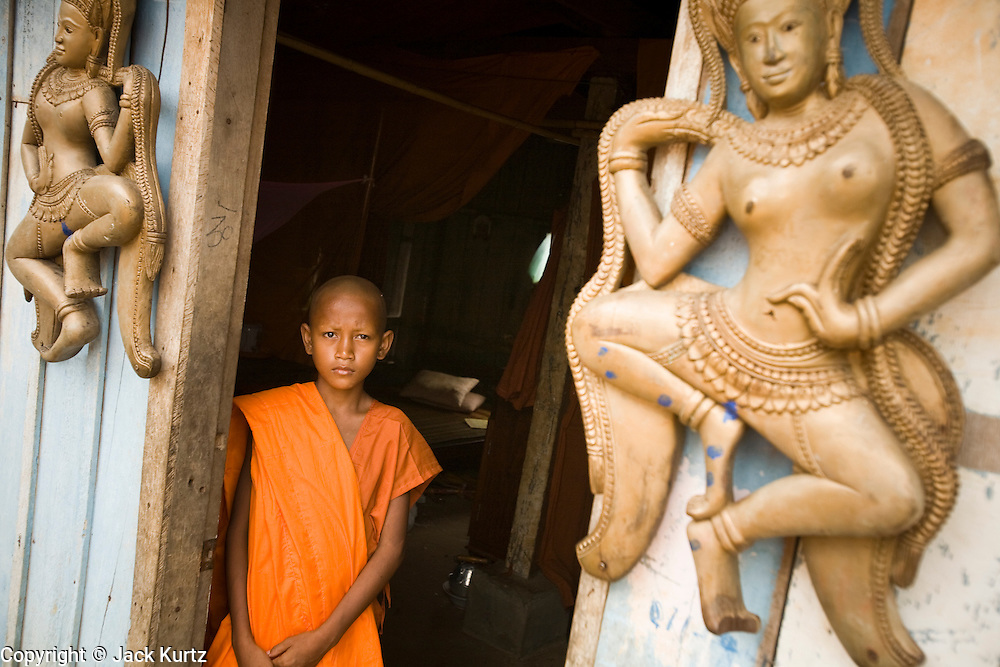 02 JULY 2006 - UDONG, CAMBODIA: A novice monk in the doorway of his dormitory at a ceremony to mark young men and boys becoming monks at a small monastery near Udong, Cambodia. Photo by Jack Kurtz / ZUMA Press