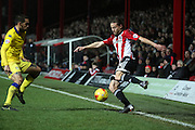 Brentford striker Lasse Vibe trying to get out of a corner after being boxed in during the Sky Bet Championship match between Brentford and Leeds United at Griffin Park, London, England on 26 January 2016. Photo by Matthew Redman.