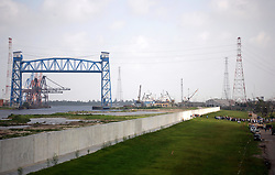 29 August 2006. New Orleans, Louisiana. Lower 9th ward. One year later and people gather at the site of the breach of the industrial canal for the Great Flood commemoration and memorial ceremony to 'honor and remember our loved ones who have passed.' People came to mark the anniversary of devastating hurricane Katrina at the site where the now repaired and allegedly in theory stronger levee flood wall. The levee breached along the industrial canal at the point where people gathered, needlessly killing hundreds of innocent civilians in the worst engineering disaster in US history.<br /> Photo Credit©; Charlie Varley/varleypix.com