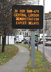 © Licensed to London News Pictures. 28/11/2011, Hammersmith, UK. A road traffic sign warning motorists heading into Central London of disruption expected on the 30th November 2011 as an estimated 2.6 million people will march through central London in support of public sector workers over changes to their pensions. Photo credit : Stephen Simpson/LNP