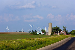 08 June 2009: A small farm along a narrow country road is surrounded by the Twin Groves Wind Farm located east of Bloomington Normal Illinois is the largest in the United States.  There are currently considerations to add even more turbines to the north of the existing field.