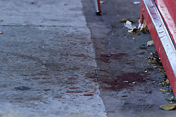 © Licensed to London News Pictures. 14/09/2019. London, UK. Blood stains at the entrance of  Metro chicken shop on Downham way.<br /> A crime scene on Downham Way in Lewisham as a murder investigation has been launched by Met Police after a 34 years old man died in hospital. The victim suffered stab and head wounds on Friday 13 Sept following a fight inside Metro chicken shop on Downham way. A 51 year old man was also injured in the fight and has since been discharged from hospital and subsequently arrested in suspicion murder. Two other men aged 40 and 46 have also been arrested on suspicion murder. Photo credit: Dinendra Haria/LNP