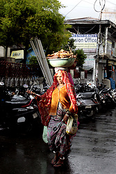 April 30, 2017 - Palampur, Himachal Predesh, India - Migrant women labour carrying waist wooden logs to cook food as going to home as rain hit in town, Palampur on Sunday. Region get fresh shower as brings the cold waves again, which put people in position to wear again woolens. (Credit Image: © Shailesh Bhatnagar/Pacific Press via ZUMA Wire)