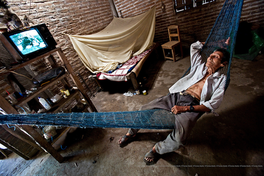 Filadelfio Martínez is paid a monthly pension of 500 pesos (approximately 35 Euros). He is very ill but has to continue farming cocoa in order to pay for his medicines.  Villa Comaltitlán, Mexico.