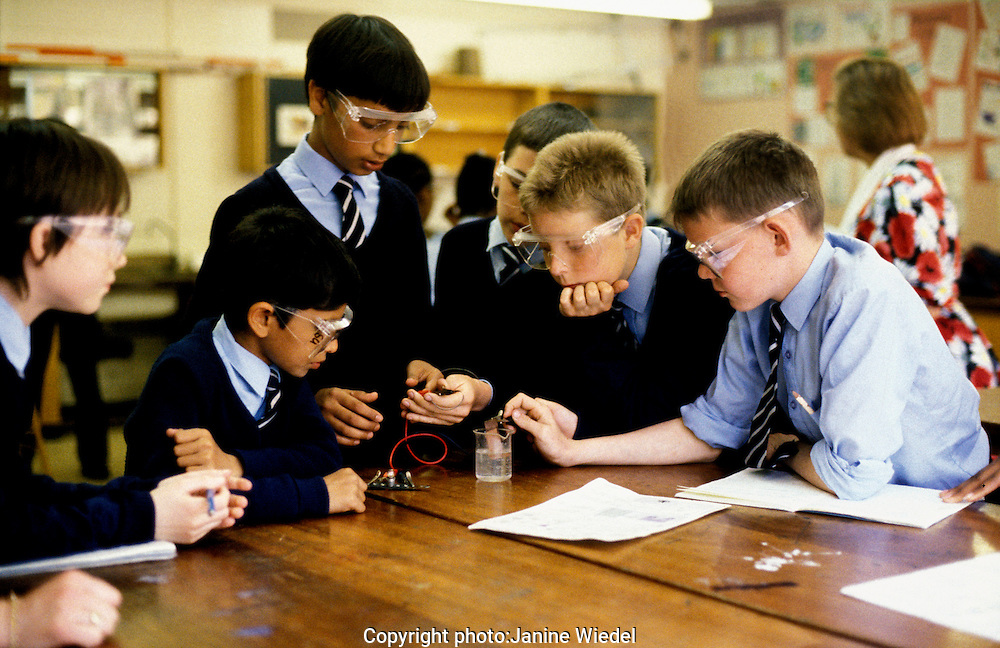 Boys working together on a science experiment in a lab at at Haris  School South London one of the first CTC schools to be set up under the Thatcher government.