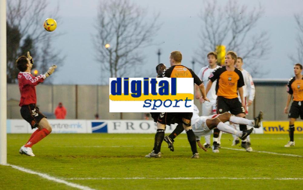 Photo: Leigh Quinnell.<br /> Milton Keynes Dons v Barnet. Coca Cola League 2. 20/01/2007. MK Dons Clive Platt(hidden) scores a second goal for  his team.