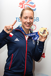 © Licensed to London News Pictures. 25/02/2014. London, UK. Womens skeleton gold medalist, Lizzy Yarnold poses with her medal at the Sofitel Hotel at Heathrow Airport on 24th February 2014. Photo credit : Vickie Flores/LNP