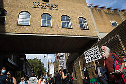 Stephen Watts, poet and translator, addresses local residents and supporters of the Save Brick Lane campaign outside the Truman Brewery following a funeral procession along Brick Lane organised in protest against the ongoing gentrification of Shoreditch on 12th September 2021 in London, United Kingdom. Campaigners are protesting in particular against plans to develop the Truman Brewery into a shopping centre and 5-storey office building. Tower Hamlets experienced more gentrification than any other London borough between 2010-2016.