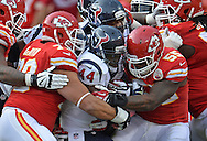 KANSAS CITY, MO - OCTOBER 20:  Defenders Akeem Jordan #55 and Mike DeVito #70 of the Kansas City Chiefs wrap up running back Ben Tate #44 of the Houston Texans during the first half on October 20, 2013 at Arrowhead Stadium in Kansas City, Missouri.  (Photo by Peter Aiken/Getty Images) *** Local Caption *** em Jordan;Mike DeVito;ben Tate