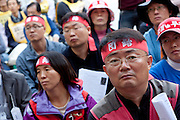 Marxist and Union activists listen at The National Worker`s Rally organised by Marxist groups and Dora Chiba labour union in Hibiya Park, Tokyo, Japan, Sunday November 1st 2009