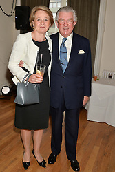 LORD & LADY MAGAN OF CASTLETOWN at a party to celebrate the publication on 'The Ape Has Stabbed Me' by Vincent Poklewski Koziell held at The Polish Club, 55 Exhibition Road, London on 1st May 2014.
