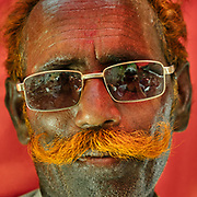 A pilgrim from the Thar desert with his mustache and hair dyed in orange Henna.