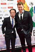 Eerste editie van de Rainbow Awards in een vol Pathé Tuschinsk. De Rainbow Awards awards worden uitgereikt aan mensen en organisaties die een belangrijke bijdrage leveren aan de Nederlandse homogemeenschap. <br /> <br /> Op de foto:  Sipke Jan Bousema en partner