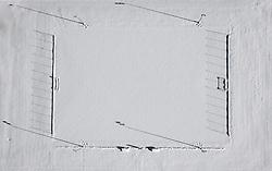 THEMENBILD - Schattenwurf auf verschneitem Fußballplatz in Matrei in Osttirol, Österreich am Dienstag, 5. Januar 2021. Luftbild, aufgenommen mit einer Drohne, nach den starken Schneefällen welche vom 5. bis 8. Dezember 2020 sowie vom 1. bis 3 Jänner 2021 über Osttirol und Oberkärnten nieder gingen, sorgten für grosse Neuschneemengen in der Region // Shadow cast on snowy soccer field in Matrei in East Tyrol, Austria on Tuesday, January 5, 2021. Aerial photo, taken with a drone, after the heavy snowfalls which fell over East Tyrol and Upper Carinthia from December 5 to 8, 2020, and from January 1 to 3, 2021, caused large amounts of new snow in the region. EXPA Pictures © 2021, PhotoCredit: EXPA/ Johann Groder
