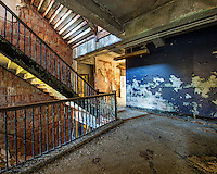 Hallways and stairs all come together at a colorful intersection inside the abandoned Chanute Air Force Base.