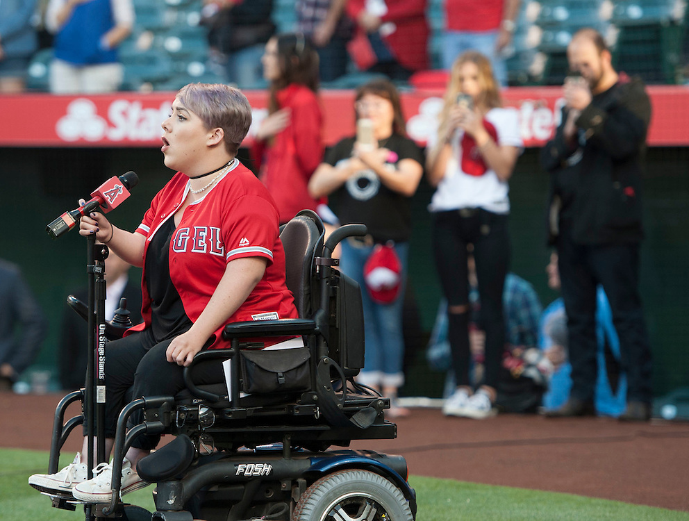 Marna Rough sings the National Anthem before the Angels game against the Minnesota Twins Monday at Angel Stadium.<br /> <br /> ///ADDITIONAL INFO:   <br /> <br /> angels.0614.kjs  ---  Photo by KEVIN SULLIVAN / Orange County Register  -- 6/13/16<br /> <br /> The Los Angeles Angels take on the Minnesota Twins Monday at Angel Stadium.