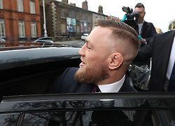 Conor McGregor (centre) leaves Dublin District Court after appearing in relation to motoring offences.