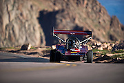 June 26-30 - Pikes Peak Colorado. Donner Billingsly runs his car during practice for the 91st running of the Pikes Peak Hill Climb.