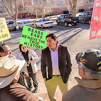 Eric Descheenie, Co-Chair of the Bears Ears Inter-Tribal Coalition speaks to protestors outside the Navajo Nation Tribal Council chambers in Window Rock Monday. Protestors oppose designating Bears Ears in Utah as a National Monument.