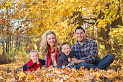 Fall family photos shot under trees in Acton.
