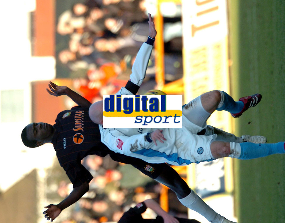 Photo: Ian Hebden.<br />Barnet FC v Wycombe Wanderers. Coca Cola League 2. 21/01/2006.<br />Barnet's Ismail Yakubu (back) challenges Wycombe's Tom Mooney (front).