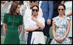 July 13, 2019 - London, London, United Kingdom - Image licensed to i-Images Picture Agency. 13/07/2019. London, United Kingdom. Kate Middleton, the Duchess of Cambridge with  Meghan Markle, the Duchess of Sussex and Pippa Middleton after Serena Williams lost in the Ladies Final on day twelve of the Wimbledon Tennis Championships in London. (Credit Image: © Stephen Lock/i-Images via ZUMA Press)