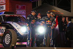 LIMA, Jan. 7, 2019  Spanish driver Carlos Sainz (R, front) and co-driver Lucas Cruz (L, front) pose on the podium during the departure ceremony at the 2019 Dakar Rally Race, Lima, Peru, on Jan. 6, 2019. The 41st edition of Dakar Rally Race kicked off in Lima, Peru. (Credit Image: © Xinhua via ZUMA Wire)