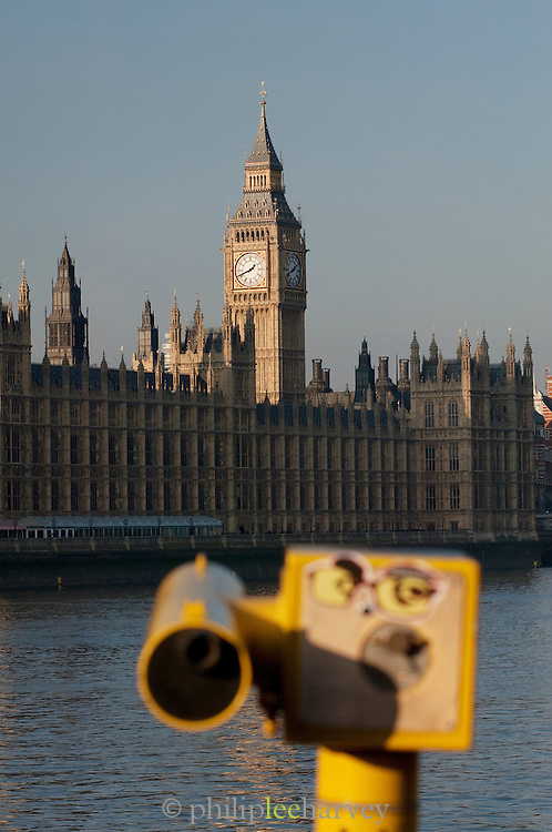 Big Ben and the Houses of Parliament on the River Thames with tourist telescope, London, UK