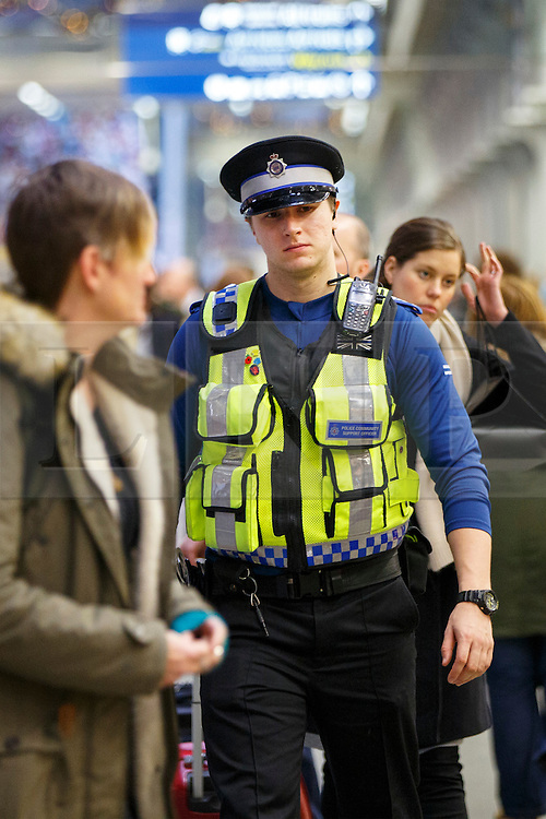 © Licensed to London News Pictures. 07/12/2015. London, UK. Police officers patrolling at St Pancras station in London on Monday, 7 December 2015. Photo credit: Tolga Akmen/LNP