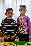 Portrait of two children at the new reconstructed local kindergarten in Marginenii de Jos.