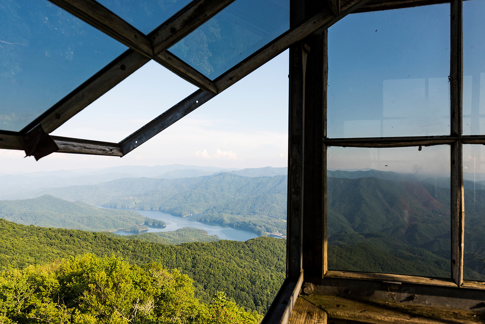 View from the abandoned Shuckstack Fire Tower in the Great Smoky Mountains National Park. On the left is Fontana Lake. The fire tower was constructed in 1934 by the Public Works Administration and is located one-tenth of a mile from the Appalachian Trail.<br /> <br /> (June 13, 2016)