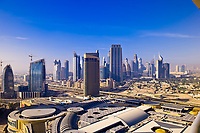 View from the Address Hotel of the downtown area of Dubai near the Burj Khalifa (Dubai Mall in foreground), Dubai, United Arab Emirates