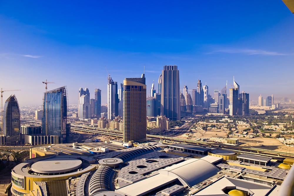 View from the Address Hotel of the downtown area of Dubai near the Burj Khalifa (Dubai Mall in foreground), Dubai, United Arab Emirates