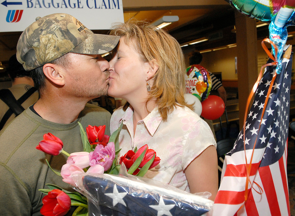 NEWS&GUIDE PHOTO / PRICE CHAMBERS.Master Sargeant Charles Kahahawai kisses his wife Hannah for one of the first times in seven months at the Jackson Hole Airport on Saturday after returning from active duty in Iraq. The Airforce electrical superintendent is retiring this month after debriefing and outproccessing in Alaska.