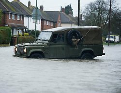 © London News Pictures. 12/02/2014. Egham, UK.  Members of the British Army Royal Engineers helping  resident in Egham, Surrey, which has been hit by heavy flooding. Torrential  rain in the area is due to raise water levels increasing the risk of further flooding. Photo credit : Ben Cawthra/LNP