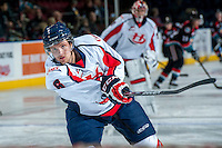KELOWNA, CANADA - OCTOBER 16: Macoy Erkamps #6 of the Lethbridge Hurricanes takes a shot during warm up against the Kelowna Rockets on October 16, 2013 at Prospera Place in Kelowna, British Columbia, Canada.   (Photo by Marissa Baecker/Shoot the Breeze)  ***  Local Caption  ***