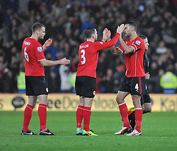 Goal scorer Cardiff City's Steven Caulker celebrates with Cardiff City's Andrew Taylor after the game. - Photo mandatory by-line: Alex James/JMP - Tel: Mobile: 07966 386802 03/11/2013 - SPORT - FOOTBALL - The Cardiff City Stadium - Cardiff - Cardiff City v Swansea City - Barclays Premier League