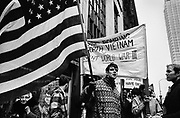 Among the first demonstrations of the nascent anti-Vietnam war movement, Swarthmore College students hold a march on the sidewalks of Philadelphia's Market Street near City Hall in 1966.