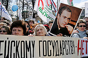 Moscow, Russia, 01/05/2004..Annual Mayday celebrations in Moscow. Pro democracy demonstrators led by Grigory Yavlinsky and Irina Khakamada outside the Lubyanka, the KGB headquarters. Speakers accused President Vladimir Putin of creating a police state, and many held posters of jailed businessman Mikhail Khodorkovsky..