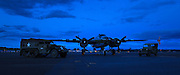 North American B-25 Mitchell, halftrack and a jeep in the twilight at Warbirds Over the West.