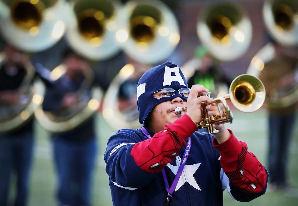 Dressed as Captain America for America Day at school, junior Santiago Sandoval plays trumpet during band practice Monday morning at Grand Island Senior High. Senior High will be defending it's Class AA parade performance, superior rating in field contest, and best overall performance titles at Harvest of Harmony in less than a week. (Independent/Matt Dixon)