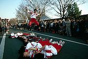 Roller skaters jump over team at Tokyo park, Japan
