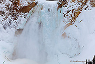 Colorful ice adorns the Lower Falls of the Yellowstone River in Yellowstone National Park, Wyoming, USA