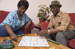 Older couple playing a game of scrabble,